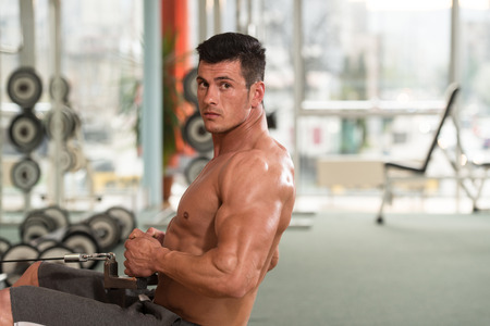 body building: Muscular Man Doing Heavy Weight Exercise For Back