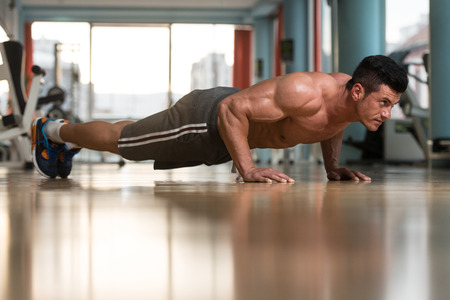 Young Adult Athlete Doing Push Ups As Part Of Bodybuilding Training Stock Photo