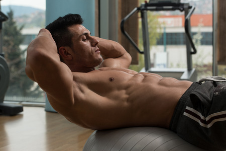 model posing: Exercising Abs Abdominals In Fitness Club