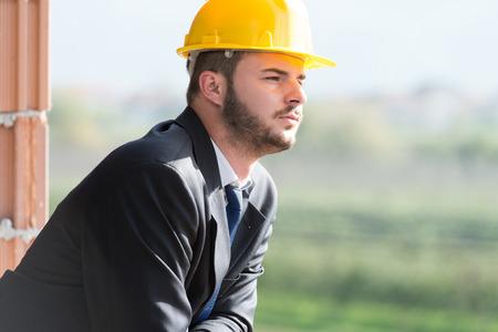 yellow helmet: Portrait Of Business Man With Yellow Helmet On Construction