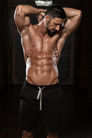 male model: Portrait Of A Physically Fit Man Showing His Well Trained Body