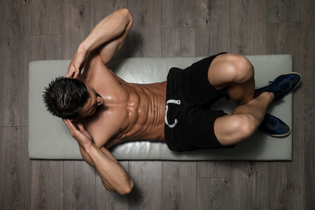 man only: Healthy Man Exercising Abdominals On Foor