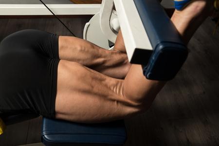 hamstrings: Bodybuilder Doing Heavy Weight Exercise For Legs Hamstrings Stock Photo