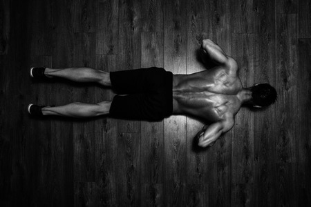 males: Healthy Athlete Doing Push Ups As Part Of Bodybuilding Training
