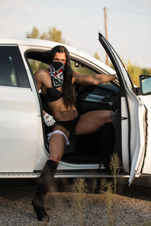 Sexy Young Woman In Underwear In The Car
