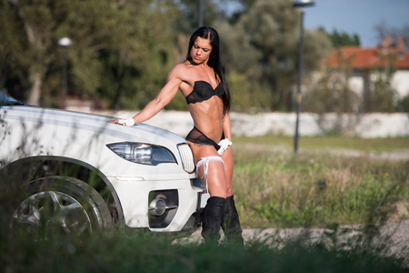 Sexy Young Woman In Underwear In Front Of A Car And Showing Her Well Trained Body Imagens