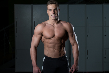bodybuilding: Portrait Of A Physically Fit Man Showing His Well Trained Body
