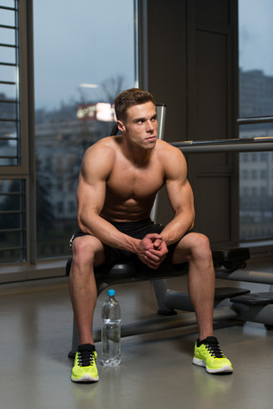 muscular body: Good Looking And Attractive Young Man With Muscular Body Relaxing In Gym