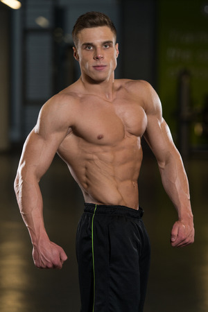 physically fit: Portrait Of A Physically Fit Man Showing His Well Trained Body
