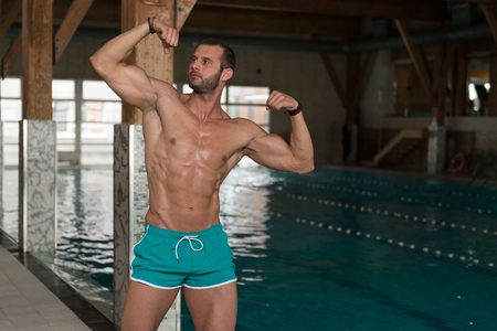 nude young: Portrait Of A Physically Fit Man Showing His Well Trained Body At Swimming Pool