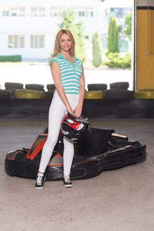 go kart: Young Woman Is Driving Go-Kart Car With Speed In A Playground Racing Track - Go Kart Is A Popular Leisure Motor Sports