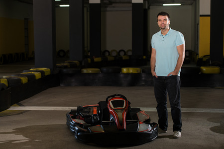 kart: Young Man Is Driving Go-Kart Car With Speed In A Playground Racing Track - Go Kart Is A Popular Leisure Motor Sports