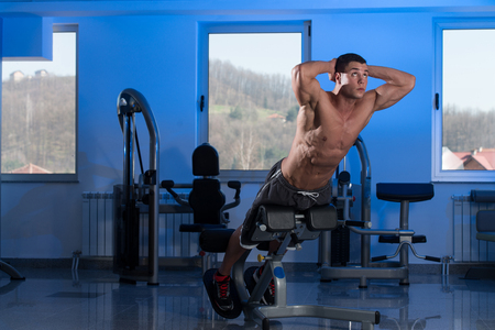 heavy weight: Bodybuilder Doing Heavy Weight Exercise For Back