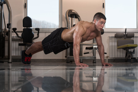 bodybuilding: Young Adult Athlete Doing Push Ups As Part Of Bodybuilding Training Stock Photo