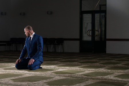 allah: Businessman Muslim Making Traditional Prayer To God Allah In The Mosque