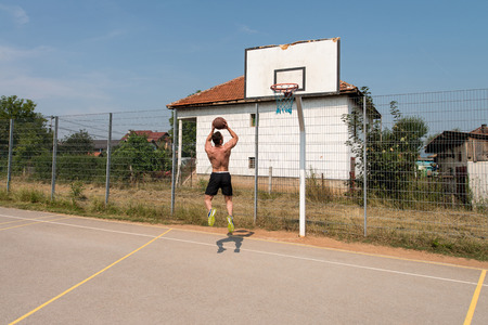 Basketball Player Bodybuilder Practicing And Posing For Basketball And Sports Athlete Concept photo