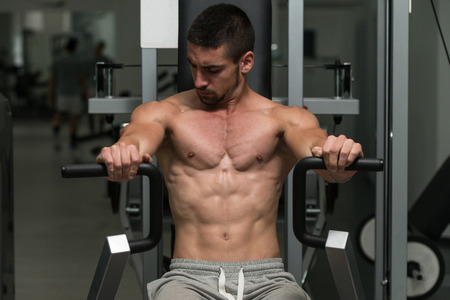 human chest: Young Bodybuilder Doing Heavy Weight Exercise For Chest