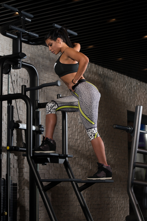 sexy latina: Portrait Of A Sexy Sporty Latina Woman In The Gym With Exercise Equipment Stock Photo