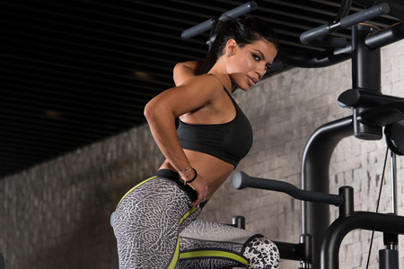 latina female: Portrait Of A Sexy Sporty Latina Woman In The Gym With Exercise Equipment Stock Photo