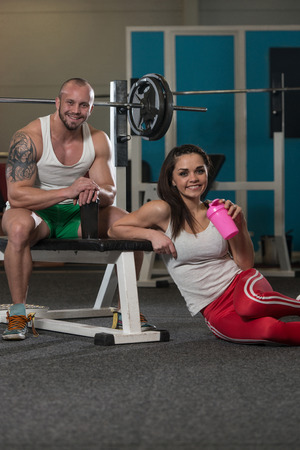 dope: Young Couple Bodybuilder With Shaker Pills And Dope For Copy Space Stock Photo