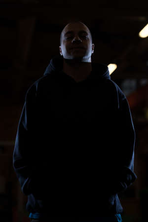 hooded sweatshirt: Young Man In Black Hooded Sweatshirt Invisible In The Night Darkness