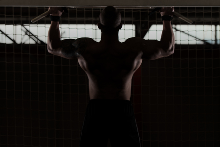 strong chin: Bodyubilder Doing Pull Ups - Chin-Ups In The Gym