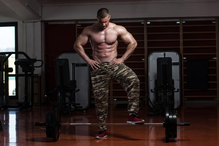 Strong Muscular Man Prepare Himself Mentally Before Lifting Deadlift