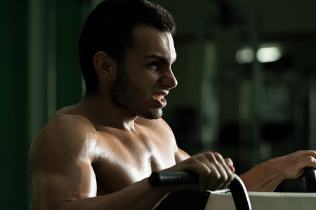 heavy weight: Young Man Doing Heavy Weight Exercise For Back