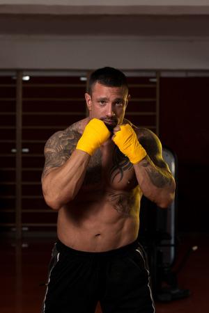 semi dress: Muscular Boxer MMA Fighter Practice His Skills Stock Photo