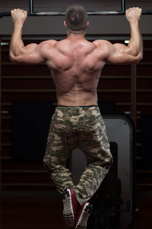 strong chin: Adult Male Athlete Doing Pull Ups - Chin-Ups In The Gym - Best Exercise For Back