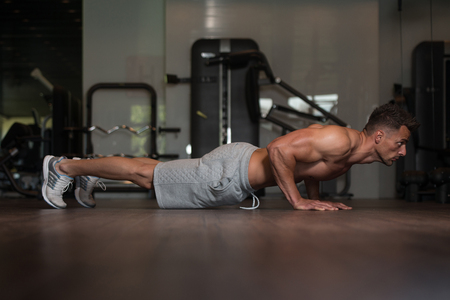Young Man Athlete Doing Pushups As Part Of Bodybuilding Training Stock Photo