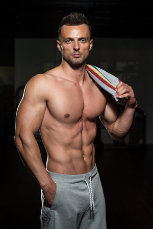 physically fit: Portrait Of A Physically Fit Man Posing With Towel