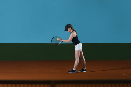to toss: Portrait Of Female Tennis Player With Racket Ready To Serves Toss Ball Stock Photo