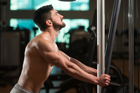 physically fit: Young Muscular Men Resting After Exercises - Portrait Of A Physically Fit Young Man Without A Shirt