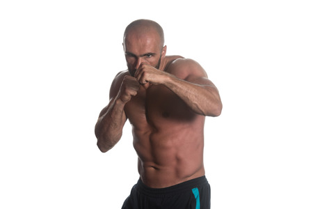 violence in sports: Young Muscular Sports Guy Boxing Workout Over White Background Isolated Stock Photo