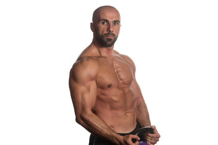 pectorals: Athletic Man Workout With Kettle Bell Over White Background
