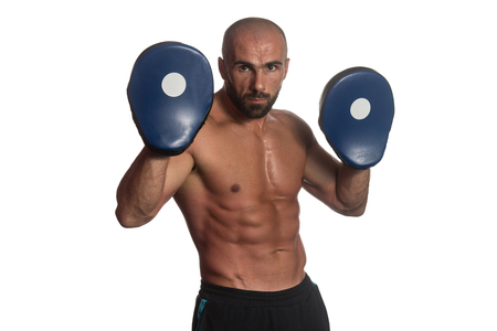 aggressiveness: Muscular Sports Guy Boxing Workout Over White Background Isolated