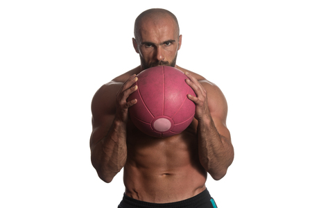 Muscular Sports Guy With Medicine Ball - Isolated On White Background