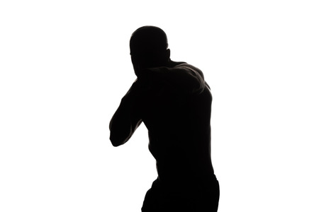 combative sport: Silhouette Muscular Boxer MMA Fighter Practice His Skills - Isolated On White Background