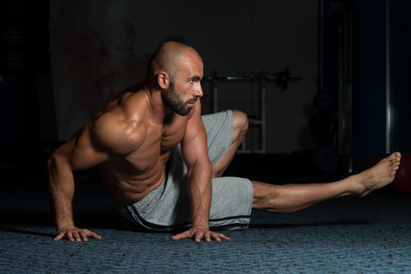 laying abs exercise: Healthy Adult Man Exercising Abdominals On Foor Stock Photo
