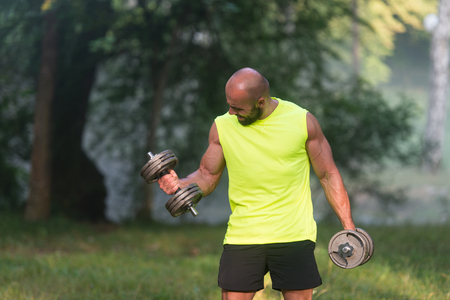 biceps: Biceps workout In Park Stock Photo