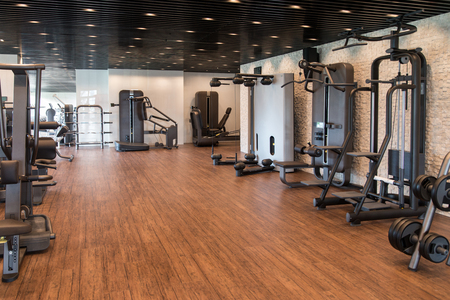 window bench: Equipment And Machines At The Modern Gym Room Fitness Center