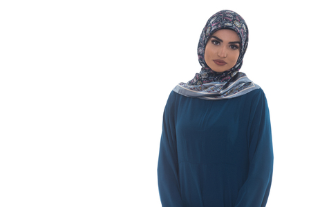 middle eastern ethnicity: Young Muslim Woman In Head Scarf With Modern Clothes - Isolated On White Stock Photo