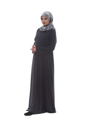 religious clothing: Pretty Young Muslim Woman Full Length Studio Portrait On White