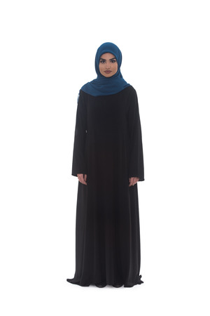 religious clothing: Fashion Portrait Of Young Beautiful Muslim Woman With Black Scarf Isolated On White Background
