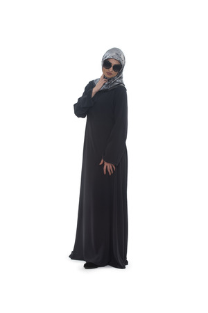 religious clothing: Fashion Portrait Of Young Beautiful Muslim Woman With Black Scarf And Sunglasses Isolated On White Background