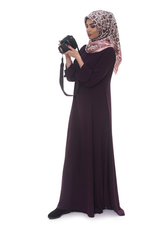 middle eastern clothing: Arab Woman Photographer Holding A Dslr Camera Isolated On A White Background Stock Photo