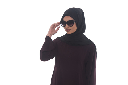 middle eastern ethnicity: Young Muslim Woman In Head Scarf With Modern Clothes And Sunglasses - Isolated On White