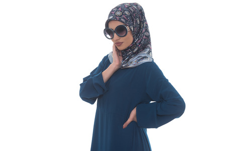 middle eastern ethnicity: Fashion Portrait Of Young Beautiful Muslim Woman With Black Scarf And Sunglasses Isolated On White Background