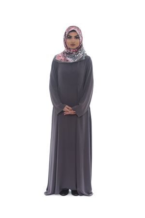 middle eastern ethnicity: Pretty Young Muslim Woman Full Length Studio Portrait On White